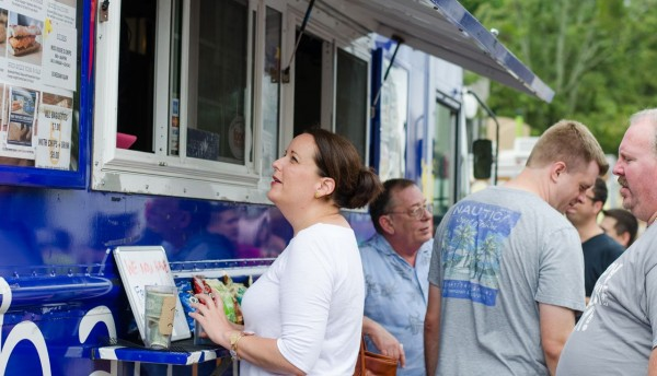 A patron orders at Baguettaboutit at Cary's 1st Town Food Truck Rodeo