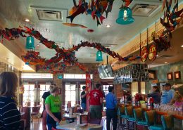 The bar at Chuy's, a restaurant known for its eclectic decor